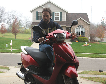 Dan Rosmarin on his Honda Elite scooter picture