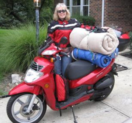 Sheila Dalton and her SYM HD200 scooter picture