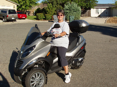 Me sitting on the new MP3. I ride it only with full gear.