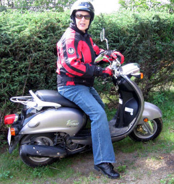 Sheila on her Yamaha Vino scooter