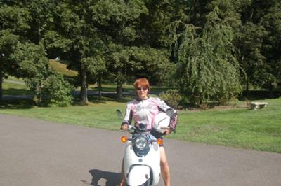 Terri, ready to ride on the Yamaha Vino