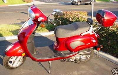A Red Lance Venice Scooter