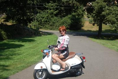 Terri on her scooter